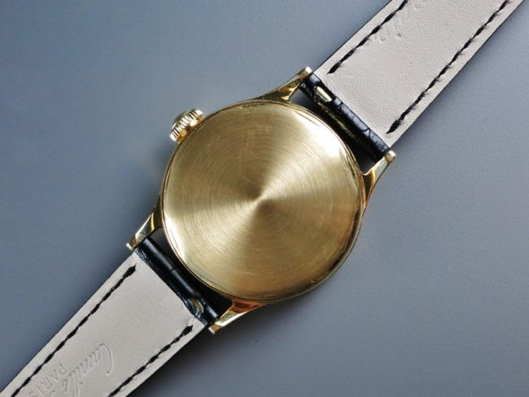 ref.565 Yellow gold with two tone dial and indirect sweep seconds