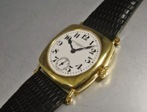 An early Cushion yellow gold with enamel dial