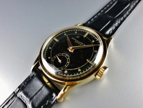 ref.96 yellow with black dial retailed by HAUSMANN & Co.